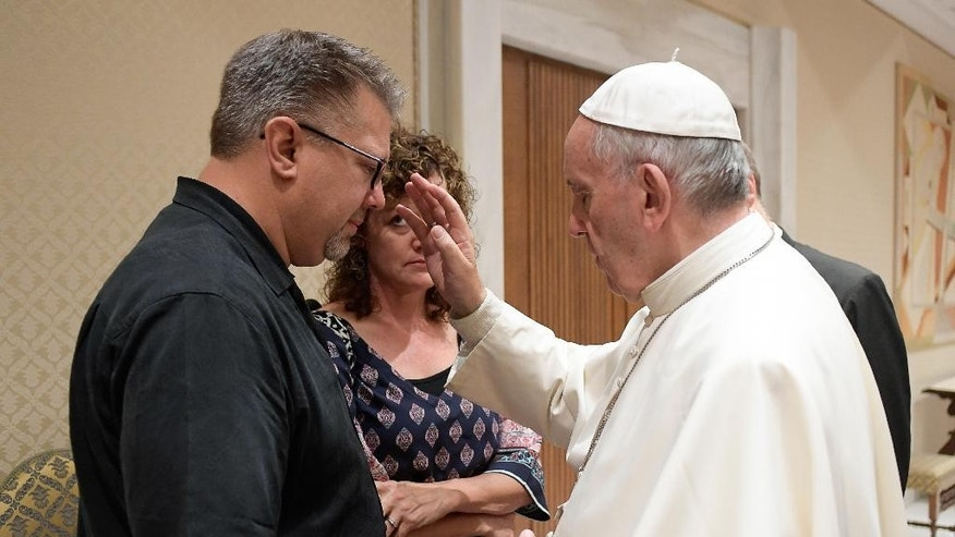 Pope Francis meets Nick, left, and Jodi Solomon.