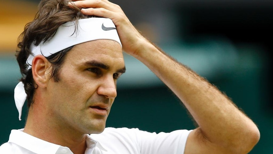 Roger Federer of Switzerland looks on during his men's singles match against Steve Johnson of the U.S on day eight of the Wimbledon Tennis Championships in London, Monday, July 4, 2016. (AP Photo/Kirsty Wigglesworth)