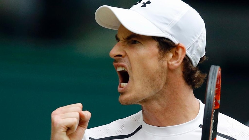 Andy Murray of Britain celebrates a point against Nick Kyrgios of Australia during their men's singles match on day eight of the Wimbledon Tennis Championships in London, Monday, July 4, 2016. (AP Photo/Kirsty Wigglesworth)
