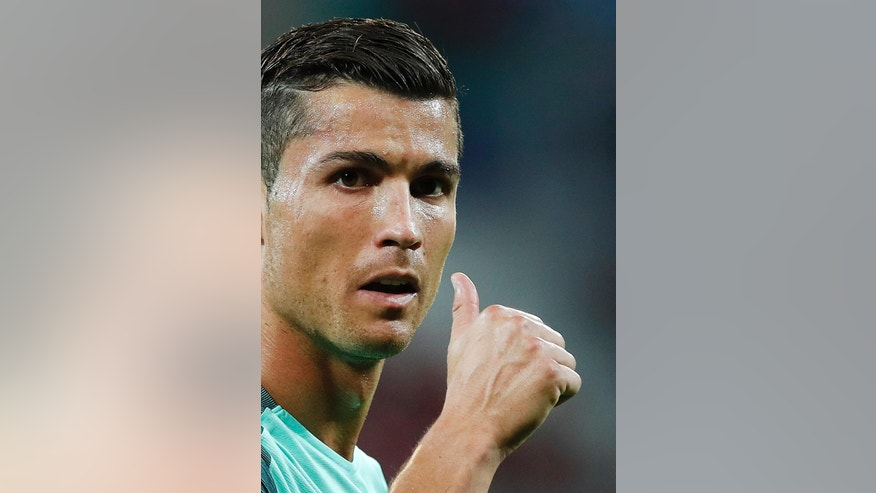 Portugal's Cristiano Ronaldo gestures during the Euro 2016 semifinal soccer match between Portugal and Wales, at the Grand Stade in Decines-­Charpieu, near Lyon, France, Wednesday, July 6, 2016. (AP Photo/Laurent Cipriani)