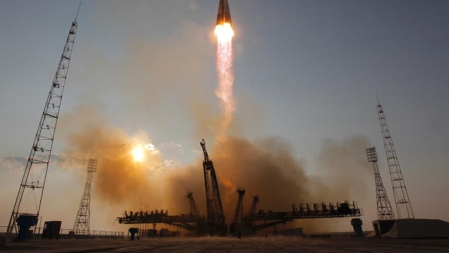 The Soyuz-FG rocket booster with Soyuz MS space ship carrying a new crew to the International Space Station, ISS, blasts off at the Russian leased Baikonur cosmodrome, Kazakhstan, Thursday, July 7, 2016. (AP Photo/Dmitri Lovetsky)