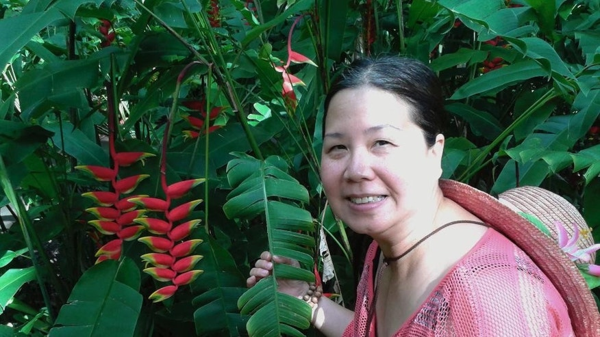 "This undated photo provided by Jeff Gillis shows his wife, Phan ""Sandy"" Phan-Gillis. A U.N. panel says China has arbitrarily detained the American woman in violation of international human rights norms, bringing her case back into public attention ahead of a visit to Beijing by U.N. Secretary General Ban Ki-moon during the week of July 3, 2016. International business consultant Phan-Gillis, 56, has been in detention in China for more than a year, accused of stealing state secrets. (Courtesy of Jeff Gillis via AP)"