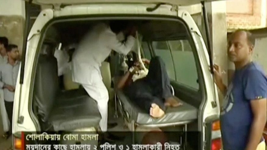 In this image made from video provided by Jamuna TV, injured people are assisted after a militant attack in Kishoreganj, about 90 kilometers (60 miles) north of the capital of Dhaka, Bangladesh, Thursday, July 7, 2016. Islamic extremists hurled homemade bombs and engaged in a gunbattle with police guarding a large Eid prayer at the end of the holy Muslim month Thursday morning. The violence comes just days after a deadly hostage crisis at a restaurant in Dhaka. (Jamuna TV via AP Video)