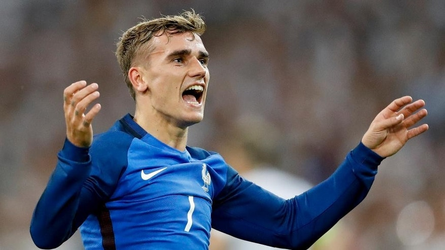 France's Antoine Griezmann celebrates his side's 2-0 win at the end of the Euro 2016 semifinal soccer match between Germany and France, at the Velodrome stadium in Marseille, France, Thursday, July 7, 2016. (AP Photo/Frank Augstein)