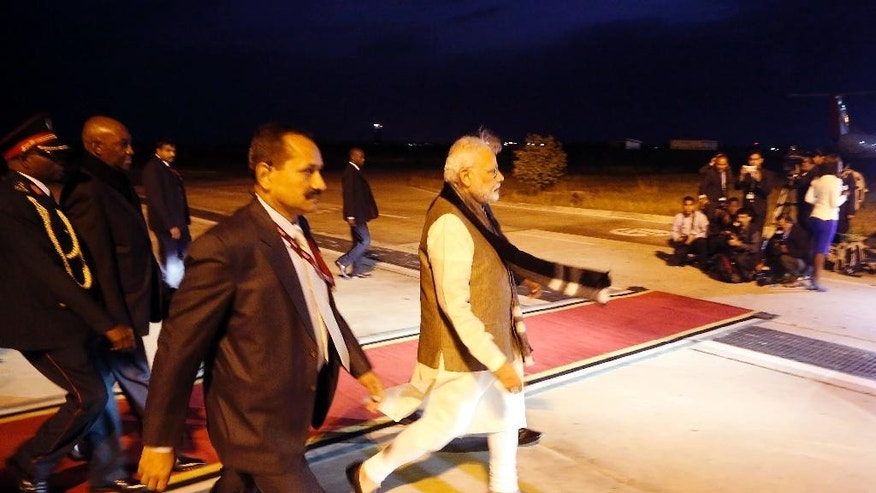 Indian Prime Minister Narendra Modi, center, arrives at the airport in Maputo, Mozambique, Thursday, July 7, 2016. India's prime minister has kicked off a four-nation African tour on a continent where China's presence has been strong, including countries that haven't been visited by an Indian leader in more than three decades. (AP Photo/Schalk van Zuydam)