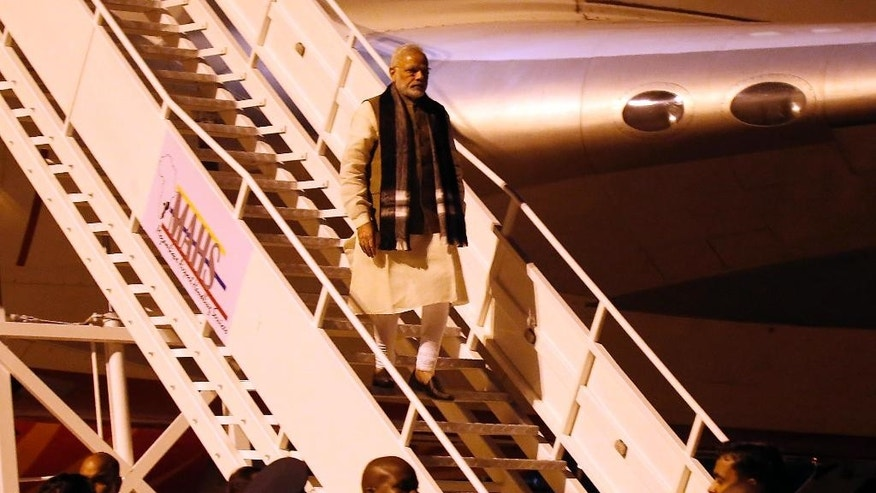 Indian Prime Minister Narendra Modi, center, arrives at the airport in Maputo, Mozambique, Thursday, July 7, 2016. India's prime minister has kicked off a four-nation African tour on a continent where China's presence has been strong, including countries that haven't been visited by an Indian leader in more than three decades.(AP Photo/Schalk van Zuydam)