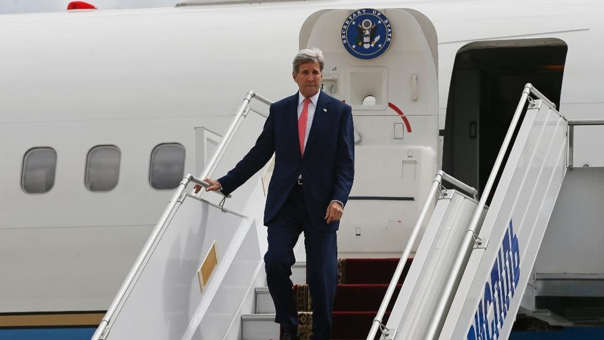 U.S. Secretary of State John Kerry arrives at the Kiev Boryspil International Airport near Kiev, Ukraine, Thursday, July 7, 2016. Secretary of State John Kerry is on the first leg of a two-day visit to Georgia and Ukraine before joining President Barack Obama at the NATO meeting in Poland. (Gleb Garanich/Pool photo via AP)