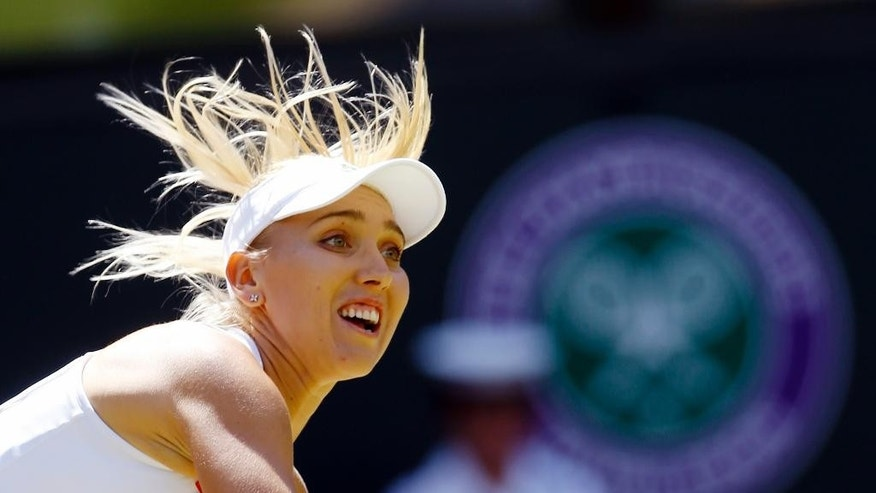 Elena Vesnina of Russia returns to Serena Williams of the U.S during their women's singles match on day eleven of the Wimbledon Tennis Championships in London, Thursday, July 7, 2016. (AP Photo/Kirsty Wigglesworth)