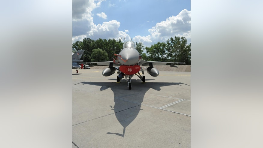 In this July 4, 2016 photo Polish Air Force F-16 fighter jet is parked at a military base, in Janow, Poland. The Polish capital Warsaw will host a two-day NATO summit starting Friday, July 8, the first time ever that it hosts a top-level meeting of the Western military alliance which it joined in 1999. (AP Photo/Alik Keplicz)
