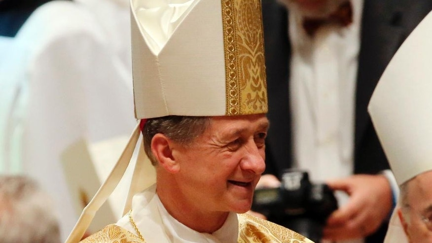 File - In this Tuesday, Nov. 18, 2014 file photo, Archbishop Blase Cupich, proceeda through Holy Name Cathedral during Cupich's Installation Mass at Holy Name Cathedral, in Chicago. Pope Francis has named Cupich to be a member of the powerful Vatican office that vets bishops' nominations, signaling he wants a key pastoral voice involved in the selection of U.S. church leaders, it was reported on Thursday, July 7, 2016. (Antonio Perez, Pool Photo via AP, File)