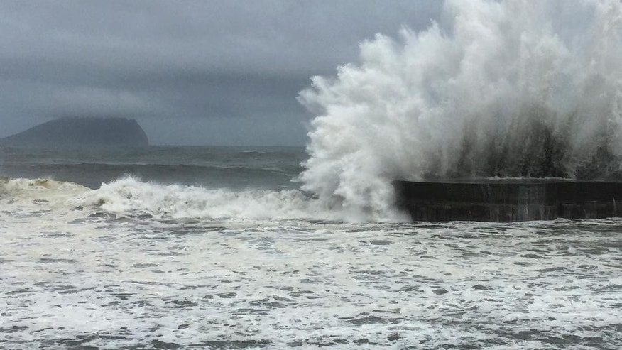 As fast-moving Typhoon Nepartak makes its way across the Philippines Sea, large waves crash against the breakwaters in Ilan County, eastern coast of Taiwan, Thursday, July 7, 2016. Nepartak is expected make landfall early Friday. (AP Photo/Johnson Lai)
