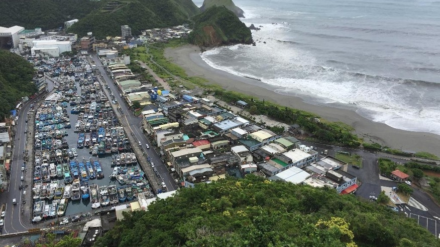 As fast-moving Typhoon Nepartak makes its way across the Philippines Sea, fishing boats are secured in a port in Ilan County, eastern coast of Taiwan, Thursday, July 7, 2016. Nepartak is expected make landfall early Friday. (AP Photo/Johnson Lai)
