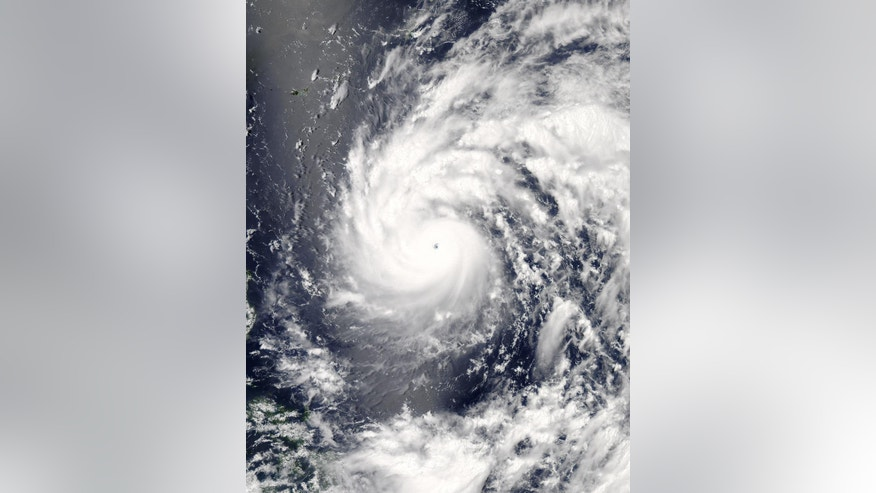 This July 6, 2016, image provided by NASA shows Typhoon Nepartak as it approaches Taiwan and the Philippines. Philippine forecasters warned fishing boats not to venture out to sea and commercial ships to watch out for big waves Thursday, July 7, 2016, as a powerful typhoon roared off the country's northeastern coast. (Jeff Schmaltz/NASA/LANCE/EOSDIS Rapid Response via AP)