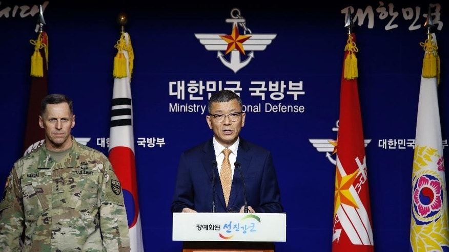 South Korean Defense Ministry's Deputy Minister for Policy Yoo Jeh-seung, center, speaks to the media about deploying the Terminal High-Altitude Area Defense, or THAAD as Lt. Gen. Thomas Vandal, the commander of U.S. Forces Korea's Eighth Army, left, listens during a media briefing at the Defense Ministry in Seoul, South Korea, Friday, July 8, 2016. (AP Photo/Lee Jin-man)