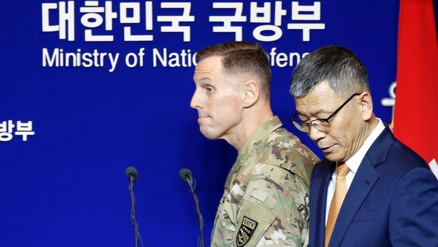 Lt. Gen. Thomas Vandal, the commander of U.S. Forces Korea's Eighth Army, left, and South Korean Defense Ministry's deputy minister for policy Yoo Jeh-seung arrive for a media briefing at Defense Ministry in Seoul, South Korea, Friday, July 8, 2016. (AP Photo/Lee Jin-man)