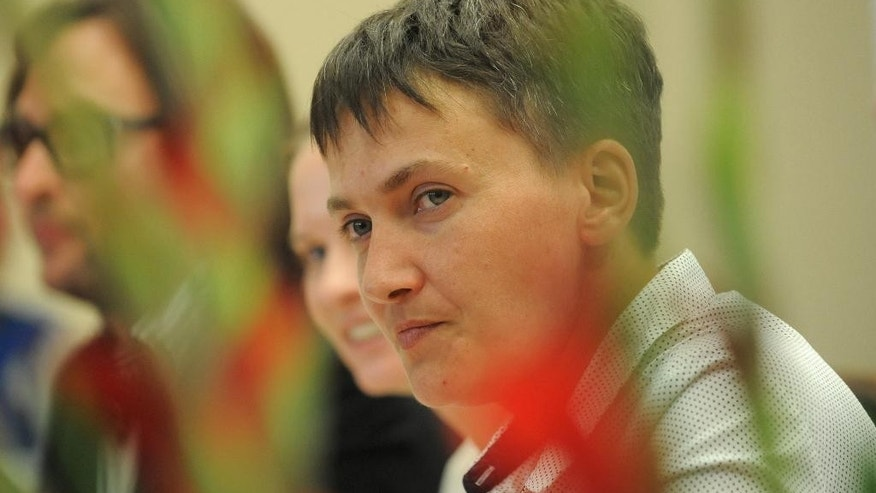 Ukrainian pilot Nadiya Savchenko takes a question from the audience during an event at the Vistula University, in Warsaw, Poland, Thursday, July 7, 2016. (AP Photo/Alik Keplicz)
