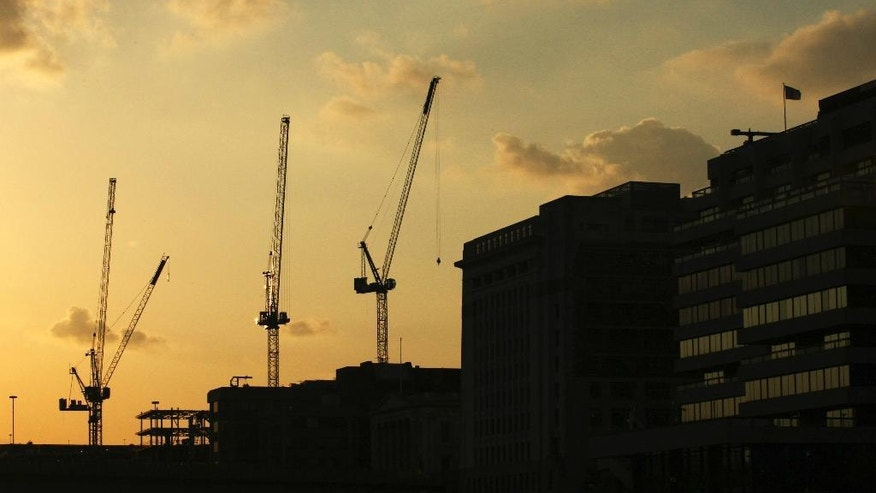 FILE - in this file photograph dated Wednesday April 23, 2008, cranes stand silhouetted against the setting sun over London. Henry Pryor, who has helped people buy homes in London for more than 30 years, says only war would be a bigger threat to the housing market than the conditions it faces now after Britain's vote to leave the European Union. (AP Photo/Matt Dunham)