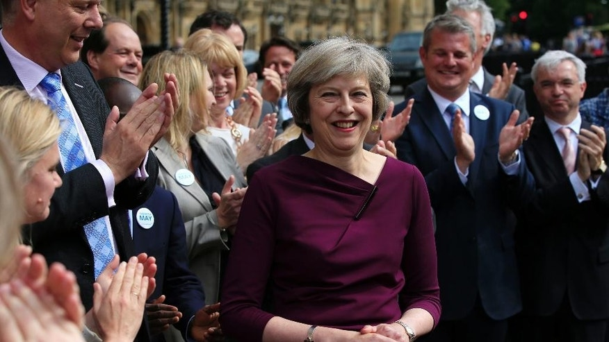 Britain's Home Secretary, Theresa May, is applauded as she makes a statement outside the Palace of Westminster, in London, after she won 199 votes for the Conservative leadership, Thursday July 7, 2016. Andrea Leadsom took 84 votes and Michael Gove took 46, meaning the UK's next prime minister will be a woman. (Jonathan Brady/PA via AP)