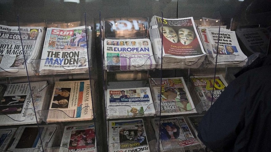 "Copies of the first edition of ""The New European"", a brand new weekly newspaper that will be published every Friday for four weeks, are displayed for sale outside a convenience store after being taken out of a delivery box, in central London, Friday, July 8, 2016. A new newspaper in Britain is aimed at the 48 percent of the population who voted to remain in the European Union in last month's referendum. (AP Photo/Matt Dunham)"