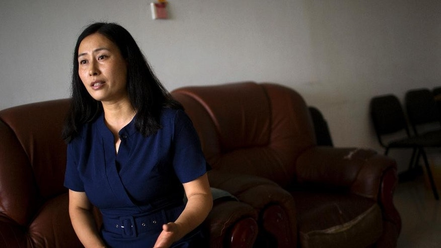 In this Wednesday, July 6, 2016 photo, Yuan Shanshan, the wife of detained Chinese lawyer Xie Yanyi, speaks during an interview in their apartment in Miyun, on the outskirts of Beijing. The Chinese government launched its largest-ever crackdown against human rights lawyers and activists on July 9, 2015, capturing or questioning of hundreds of people nationwide in a campaign that sent a chill over the country's legal system. Nearly two dozen lawyers, including Xie, remain under detention and face charges including subverting state power - charges condemned by international human rights groups and Western governments - while in the outside world, their families struggle with the fallout. (AP Photo/Mark Schiefelbein)