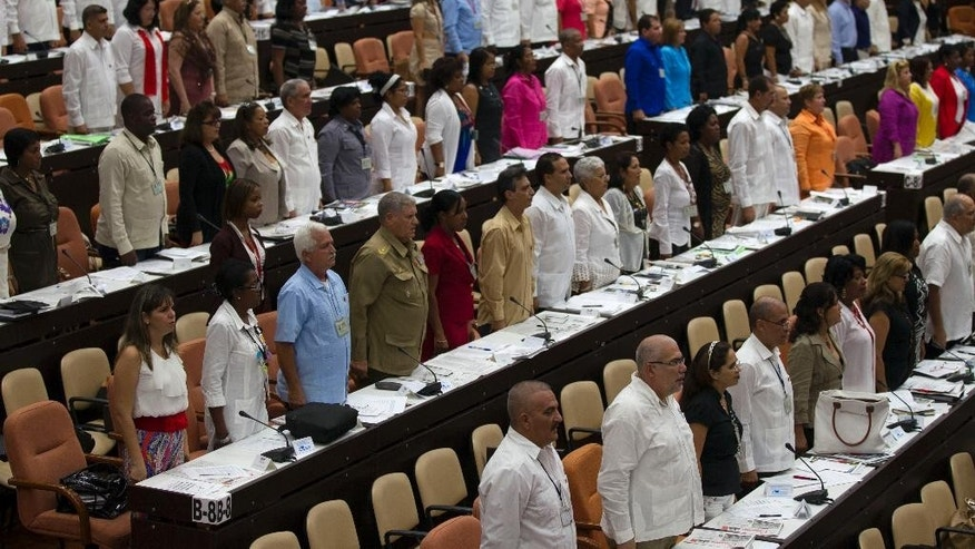Lawmakers attend a National Assembly session in Havana, Cuba, Friday, July 8, 2016. Cuba's parliament has convened for one of its twice-annual plenary sessions amid warnings from government officials that the country faces energy restrictions during tough fiscal times. (Ladyrene Perez, Cubadebate via AP)