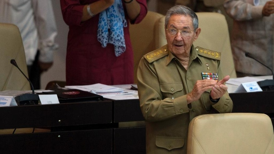Cuba's President Raul Castro applauds during the opening of the National Assembly session in Havana, Cuba, Friday, July 8, 2016. Cuba's parliament has convened for one of its one of its twice-annual plenary sessions amid warnings from government officials that the country faces energy restrictions during tough fiscal times. (Ismael Francisco, Cubadebate via AP)