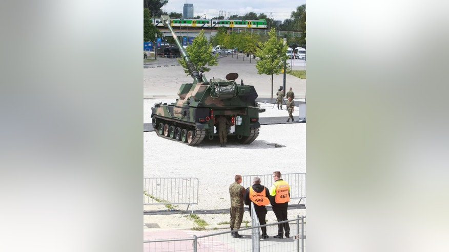 Polish Army soldiers prepare a display of Polish-made combat vehicles in front of the National Stadium, the venue of the upcoming NATO summit, in Warsaw, Poland, Wednesday, July 6, 2016. The Polish capital will host a two-day NATO summit starting Friday, the first time ever that it hosts a top-level meeting of the Western military alliance which it joined in 1999. (AP Photo/Czarek Sokolowski)