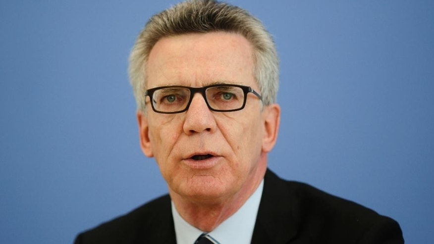 FILE - In this May 23, 2016 file photo German Interior Minister Thomas de Maiziere speaks during a news conference, in Berlin, Germany. Some 222,000 asylum-seekers arrived in Germany in the first half of this year, the government said Friday, July 8, 2016. De Maiziere said he isn't making any forecast for how many will arrive in 2016, given uncertainty about future developments. (AP Photo/Markus Schreiber, file)