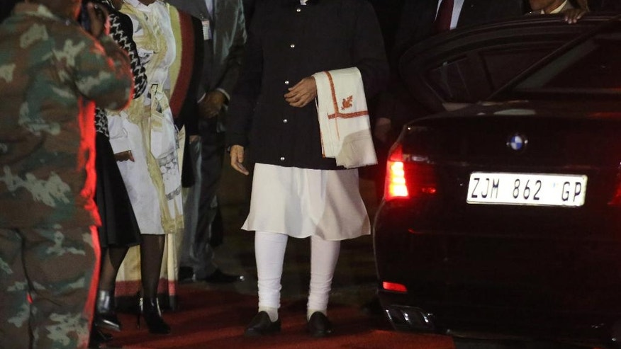 Indian Prime Minister Narendra Modi, on his arrival in Pretoria, South Africa, Thursday, July 7, 2016 on the second leg of his four-nation African visit. Modi will spend two days in South Africa. (AP Photo/Denis Farrell)