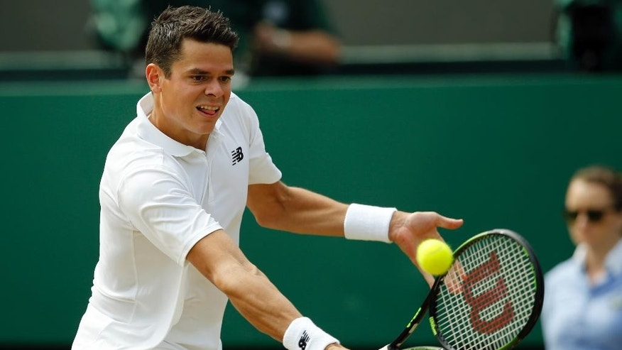 Milos Raonic of Canada returns to Sam Querrey of the U.S during their men's singles match on day ten of the Wimbledon Tennis Championships in London, Wednesday, July 6, 2016. (AP Photo/Alastair Grant)