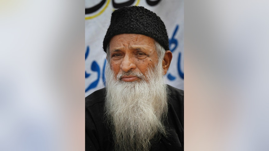 FILE - In this Monday, Aug. 2, 2010 file photo, Pakistani humanitarian leader Abdul Sattar Edhi collects donations in Peshawar, Pakistan. The family of Pakistan's legendary philanthropist Abdul Sattar Edhi has asked people to pray for him after his health deteriorated further and he was said to be breathing through a ventilator. (AP Photo/Anjum Naveed, File)