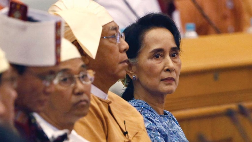 FILE - In this March 30, 2016 file photo, Aung San Suu Kyi, right, and Htin Kyaw, second from right, newly elected president of Myanmar, attend a ceremony to take oaths in parliament in Naypyitaw, Myanmar. For nearly 30 years, Aung San Suu Kyi starred as arguably the world's most prominent and revered political prisoner, a courageous champion of human rights and democracy in her military-ruled nation. As she completes her first 100 days in power, the Nobel Prize laureate's halo has all but vaporized on the global stage: Suu Kyi is being assailed for ignoring the plight of the oppressed Rohingya Muslims, failing to stop atrocities against other ethnic minorities and abetting moves to erase from collective memory the bloody history of the generals she replaced. (AP Photo/Aung Shine Oo, File)
