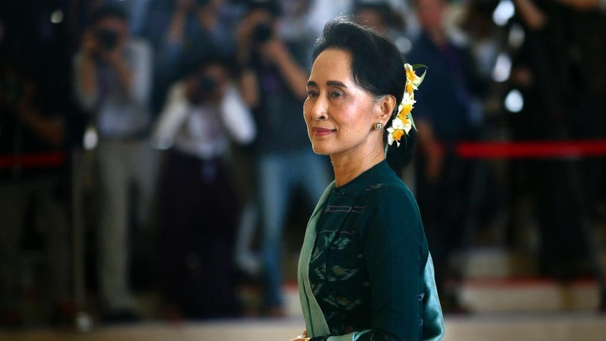 FILE - In this March 15, 2016 file photo, National League for Democracy party (NLD) leader Aung San Suu Kyi arrives in Manama's parliament in Naypyitaw, Myanmar. Aung San Suu Kyi starred as arguably the world's most prominent and revered political prisoner, a courageous champion of human rights and democracy in her military-ruled nation. As she completes her first 100 days in power, the Nobel Prize laureate's halo has all but vaporized on the global stage: Suu Kyi is being assailed for ignoring the plight of the oppressed Rohingya Muslims, failing to stop atrocities against other ethnic minorities and abetting moves to erase from collective memory the bloody history of the generals she replaced.  (AP Photo/Gemunu Amarasinghe, File)