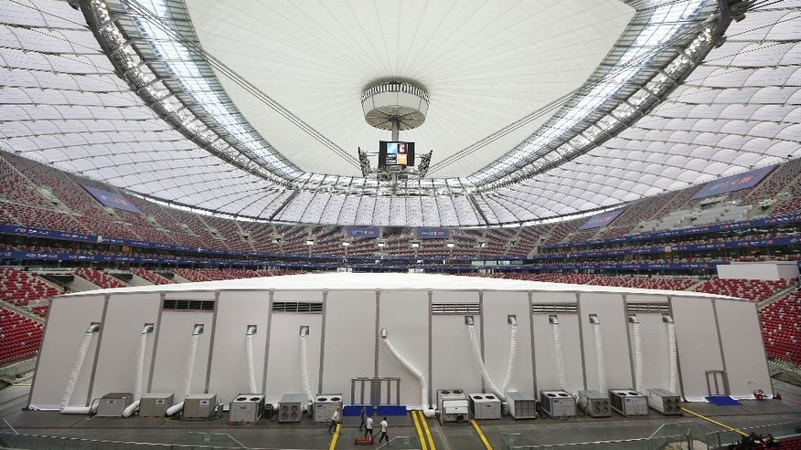 A tent stands ready to welcome the heads of the 28 NATO members and other officials for a NATO summit at the National Stadium in Warsaw, Poland, Thursday, July 7, 2016. The Polish capital Warsaw will host a two-day NATO summit starting Friday, July 8, the first time ever that it hosts a top-level meeting of the Western military alliance which it joined in 1999. (AP Photo/Czarek Sokolowski)