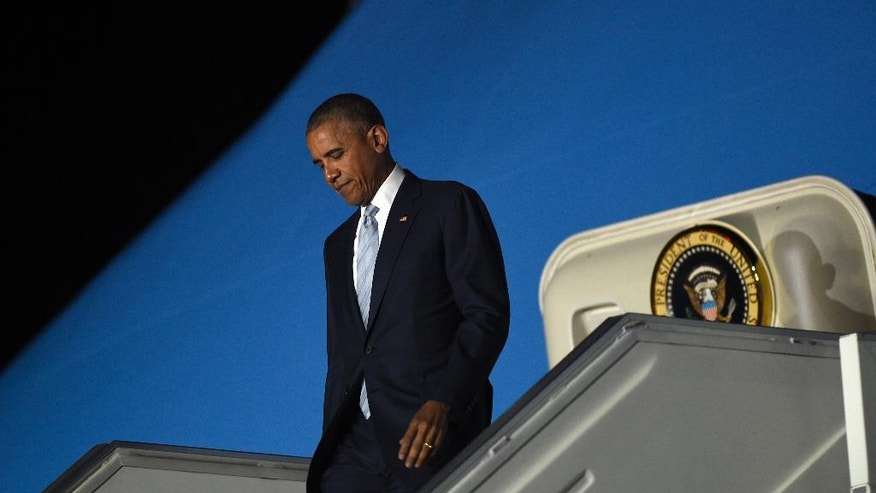 President Barack Obama walks down the steps of Air Force One after arriving at Chopin Airport in Warsaw, Poland, Friday, July 8, 2016. Obama traveled to Poland to attend the NATO summit and then will travel on to Spain. (AP Photo/Susan Walsh)