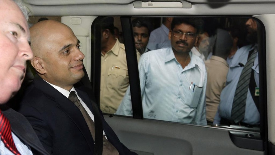 Britain's Business Secretary Sajid Javid leaves after a meeting with Tata Steel executives amid reports that the Indian conglomerate is prepared to sell some of its U.K. plants, in Mumbai, India, Friday, July 8, 2016. Tata is looking to dispose of its specialty steel businesses in Hartlepool, Rotherham and Stocksbridge, but has so far held off any decision on what to do with its plant in Port Talbot, in Wales. (AP Photo/ Rajanish Kakade )
