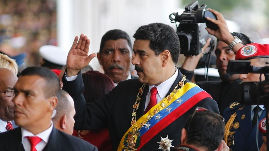 In this July 5, 2016 photo, Venezuela's President Nicolas Maduro waves to supporters before a parade marking Venezuela's Independence Day in Caracas, Venezuela. When Venezuela's opposition lawmakers took over the congress in January, they vowed it was the beginning of the end for Maduro. But Maduro has since managed to almost completely sideline the legislature, and now the ruling socialist party is talking about shutting it down altogether. (AP Photo/Ariana Cubillos)