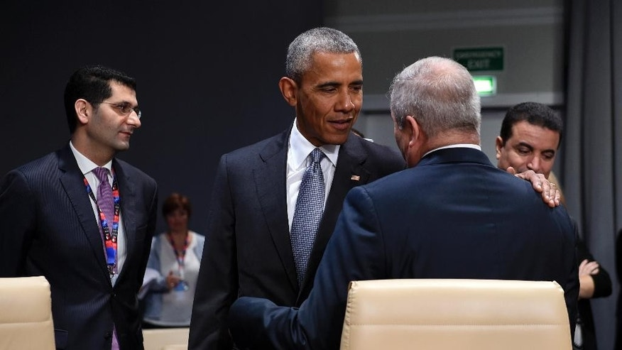 President Barack Obama talks with Jordanian Foreign Minister Nasser Judeh as he arrives for the start of a session of the North Atlantic Council at PGE National Stadium in Warsaw, Poland, Saturday, July 9, 2016. (AP Photo/Susan Walsh)