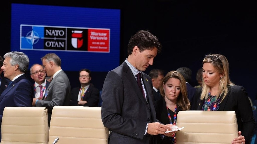 Canadian Prime Minister Justin Trudeau arrives for a session of the North Atlantic Council at PGE National Stadium in Warsaw, Poland, Saturday, July 9, 2016. (AP Photo/Susan Walsh)