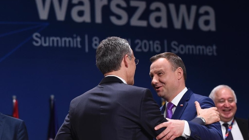 NATO Secretary General Jens Stoltenberg, left, talks with Polish President Andrzej Duda before the start of a session of the North Atlantic Council at PGE National Stadium in Warsaw, Poland, Saturday, July 9, 2016. (AP Photo/Susan Walsh)