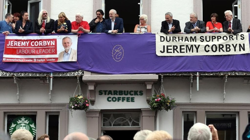 Britain's Labour party leader Jeremy Corbyn, top centre, looks on as miners parade during the Durham Miners' Gala in Durham, England, Saturday July 9, 2016.  Corbyn will face a leadership contest on upcoming Monday, according to an announcement from party spokeswoman on business issues, Angela Eagle. (Scott Heppell / PA via AP)