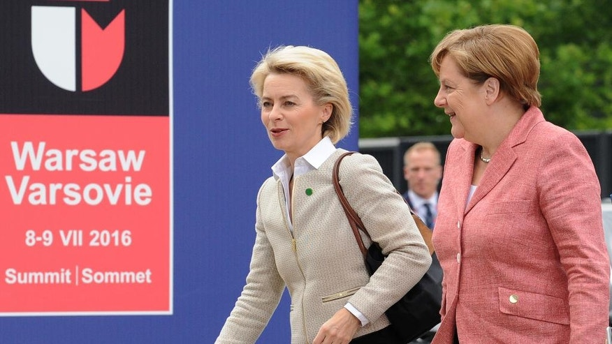 German Chancellor Angela Merkel, right, and German Defense Minister Ursula von der Leyen arrive for sessions on the second day of the NATO Summit, in Warsaw, Poland, Saturday, July 9, 2016. US President Barack Obama and leaders of the 27 other NATO countries are taking decisions in Warsaw on how to deal with a resurgent Russia, violent extremist organizations like Islamic State, attacks in cyberspace and other menaces to allies' security. (AP Photo/Alik Keplicz)