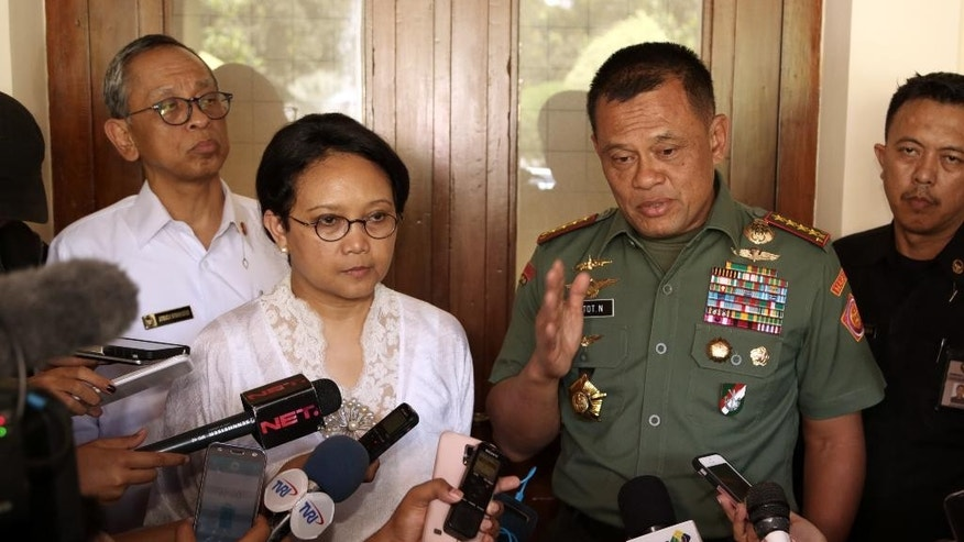 Indonesian Armed Forces Chief Gen. Gatot Nurmantyo, right, speaks to the media as Foreign Minister Retno Marsudi, second left, listens after their meeting on the abduction of three Indonesians by suspected Abu Sayyaf militants, in Jakarta, Indonesia, Monday, July 11, 2016. The suspected militants kidnapped three Indonesian fishermen on the weekend in the latest of a series of incidents highlighting weak security in the Celebes Sea that borders Malaysia, Indonesia and the Philippines. (AP Photo/Achmad Ibrahim)