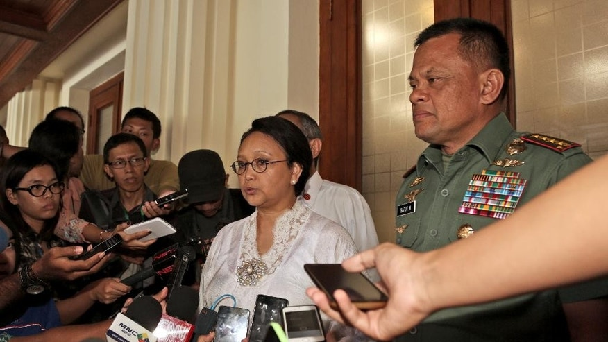 Indonesian Foreign Minister Retno Marsudi, left, speaks to the media as Armed Forces Chief Gen. Gatot Nurmantyo, right, listens after their meeting on the abduction of three Indonesians by suspected Abu Sayyaf militants, in Jakarta, Indonesia, Monday, July 11, 2016. The suspected militants kidnapped three Indonesian fishermen on the weekend in the latest of a series of incidents highlighting weak security in the Celebes Sea that borders Malaysia, Indonesia and the Philippines. (AP Photo/Achmad Ibrahim)
