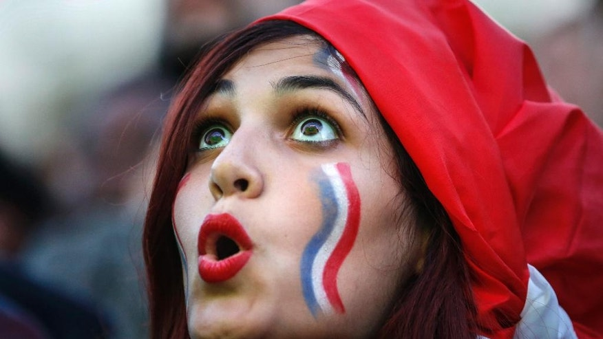A French supporter watches the Euro 2016 semifinal soccer match between Germany and France,Thursday, July 7, 2016 in the  Paris fan zone. (AP Photo/Kamil Zihnioglu)