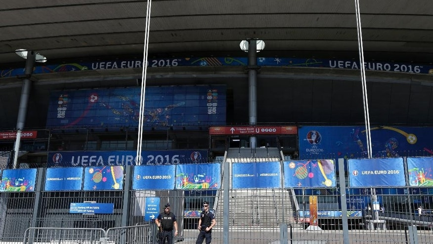 Policemen stand guard prior the Euro 2016 final soccer match between Portugal and France at the Stade de France in Saint-Denis, north of Paris, Sunday, July 10, 2016. (AP Photo/)