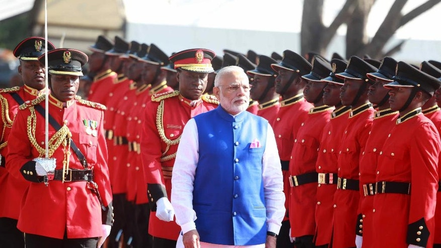 Indian Prime Minister Narendra Modi inspects a guard of honor during an official welcome ceremony for him at State House Grounds in Dar es Salaam, Sunday July 10, 2016. Modi is on the third leg of his Africa tour. (AP Photo/Khalfan Said)