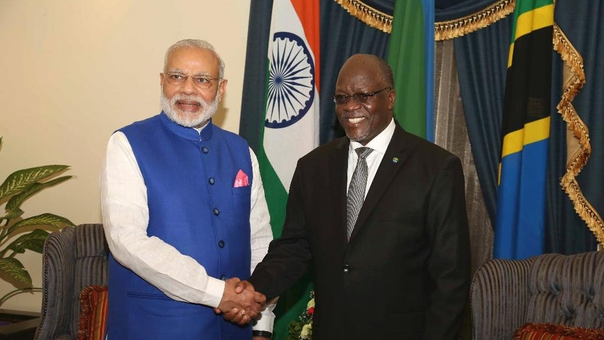 Indian Prime Minister Narendra Modi, left, poses with Tanzania President John Pombe Magufuli for a photo at State House in Dar es Salaam, Tanzania Sunday July 10, 2016. Modi is on his third leg of Africa tour. (AP Photo/Khalfan Said)