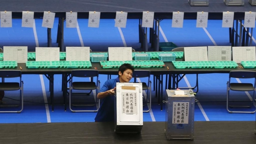 An election staff member carries a ballot box for voting at a ballot counting center in Tokyo, Sunday, July 10, 2016.  Japan's ruling coalition was a clear winner in Sunday's parliamentary election, Japanese media exit polls indicated, paving the way for Prime Minister Shinzo Abe to push ahead with his economic revival policies, but also possibly changing the nation's postwar pacifist constitution.(AP Photo/Koji Sasahara)