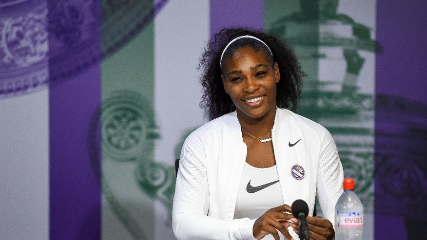 Serena Williams of the U.S smiles during a press conference, after winning the women's singles final against Angelique Kerber of Germany pn day thirteen of the Wimbledon Tennis Championships in London, Saturday, July 9, 2016. (Jon Buckle/Pool Photo via AP)